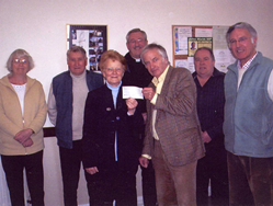 Cheques for Parish Church and Village Hall being presented