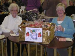 Anne and June with raffle for a hamper