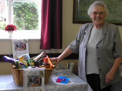 Mrs Kath Whitcomb with food hamper she kindly donated