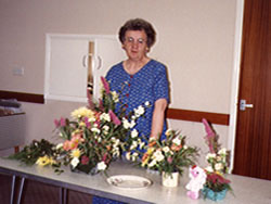 Marjorie Clayworth with some of her flower arrangements