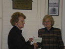 Mrs Shirley Brasher presenting cheque to Village Hall Chair Mrs Joan Sangar