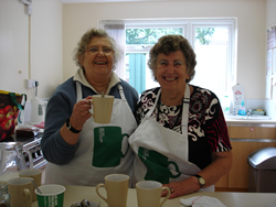 Kath and Shirley serving coffees