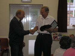 Parish Council Chair Brian Suart making the presentation to Mr John Smith