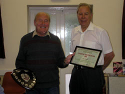 Mr John Smith with his certificate and shield