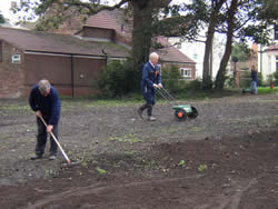 ...raking and sowing grass seed