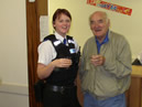 Our PCSO and District Councillor Ken Bullivant making a toast - with orange juice of course!