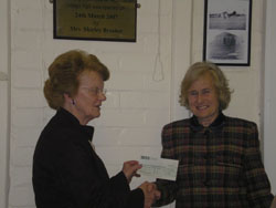 Mrs Shirley Brasher presenting cheque