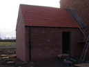 Outside toilet block roof complete